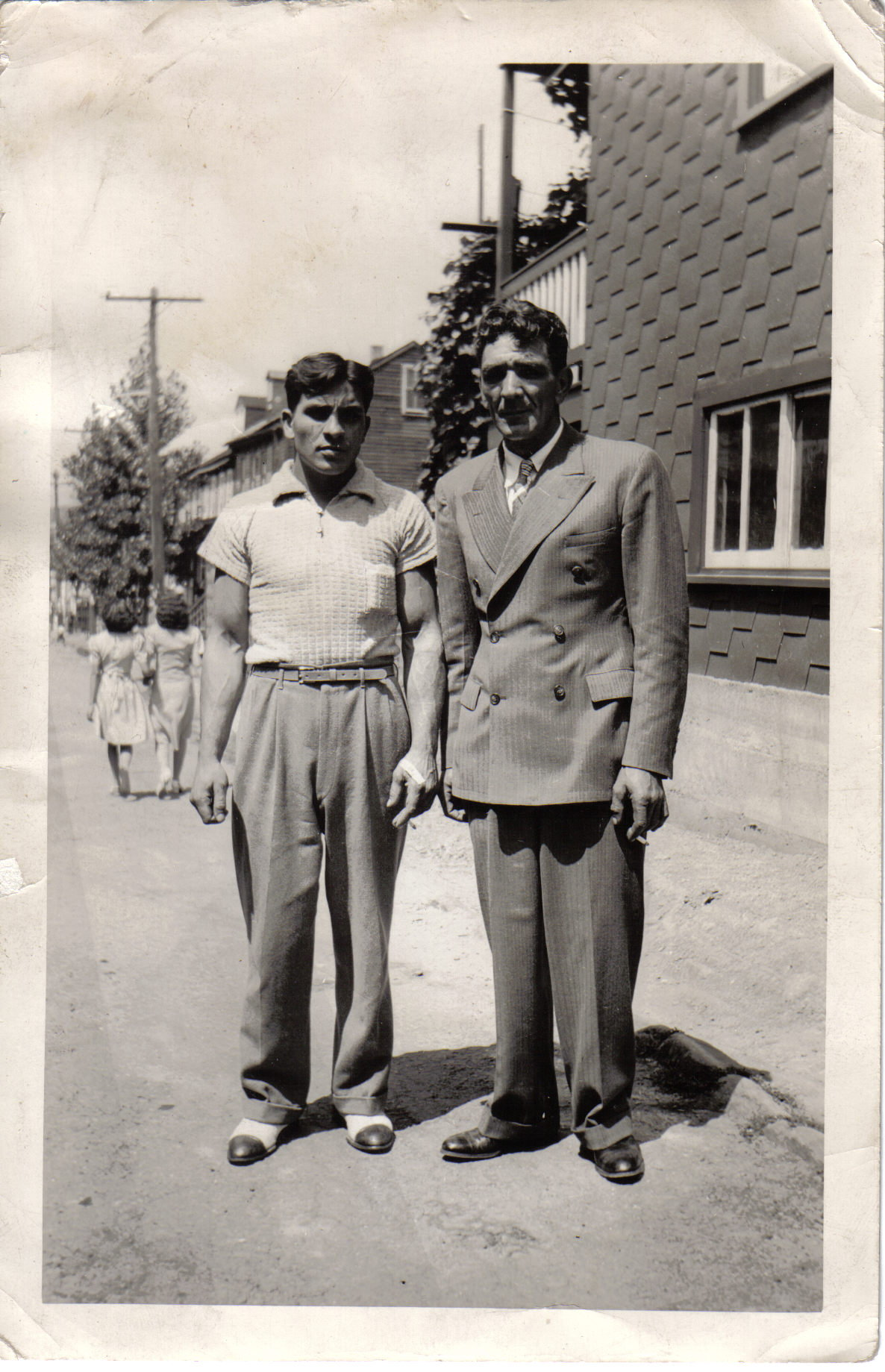 My, my grandfather looks handsome in his suit with his brother -in -law
