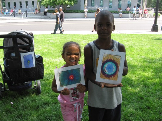 A sister and brother show me their Spin Art creations.