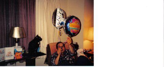 Dad looks at birthday balloons