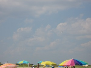 Summer Blue sky with crayon-colored beach umbrellas