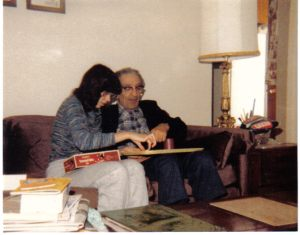 My maternal grandfather and I playing a board game after dinner as a teen.