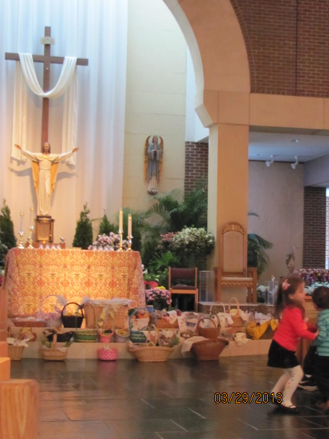 """The alter of St. Augustine of Canterbury church with the Easter """"food """" baskets ready for the blessing."""