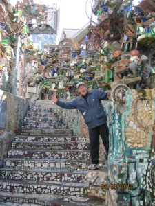Magic Gardens- Pat waves along the mosaic stairway.