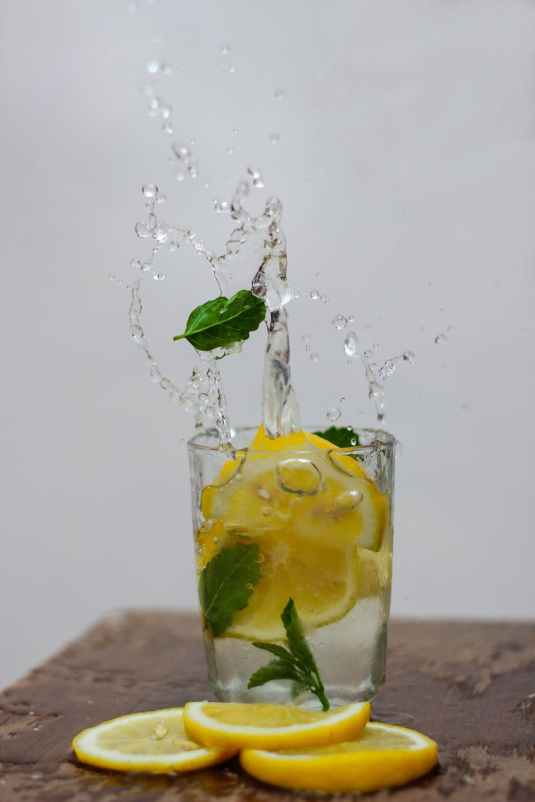 photo of lemon in drinking glass with water